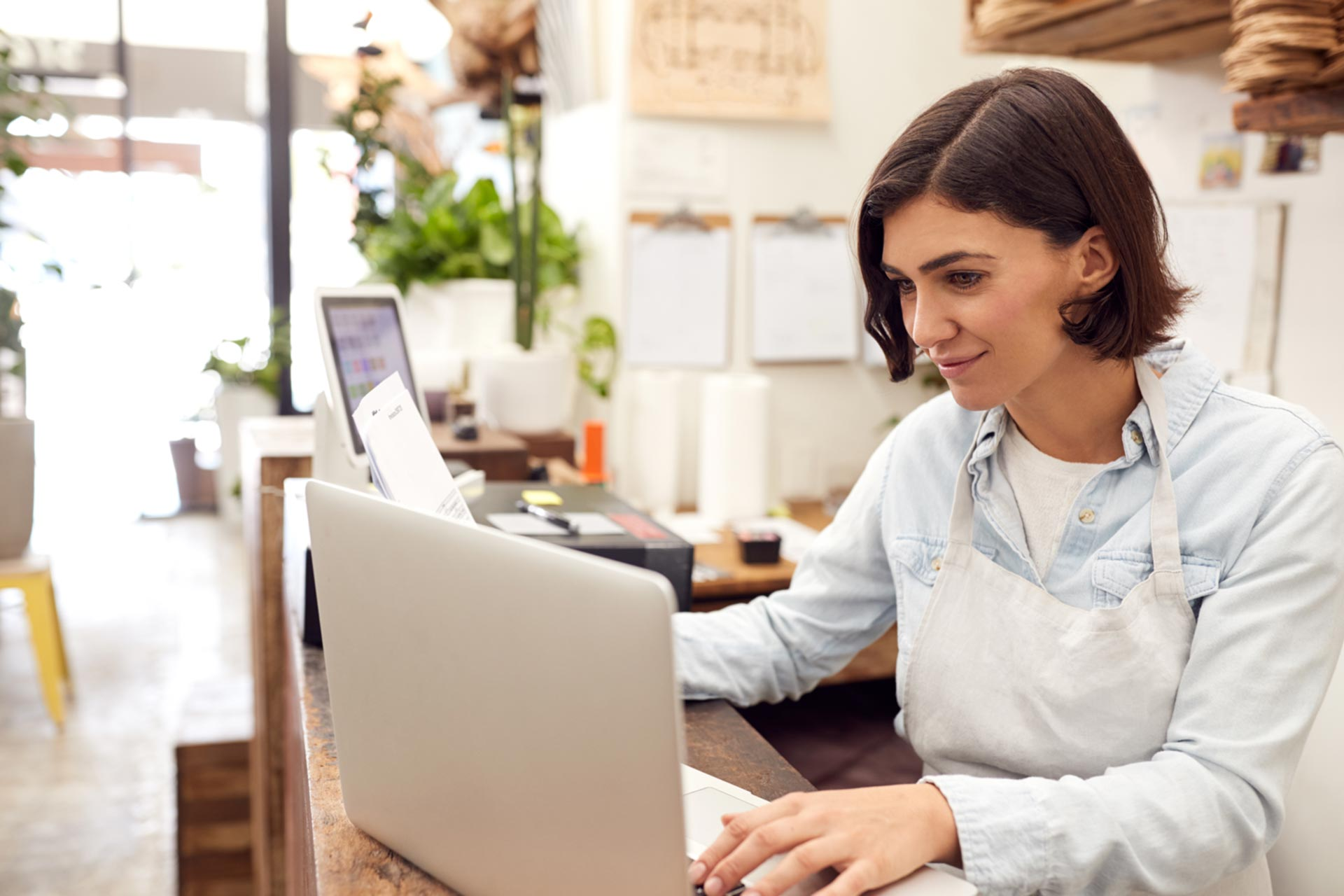 DBA business owner checking her laptop