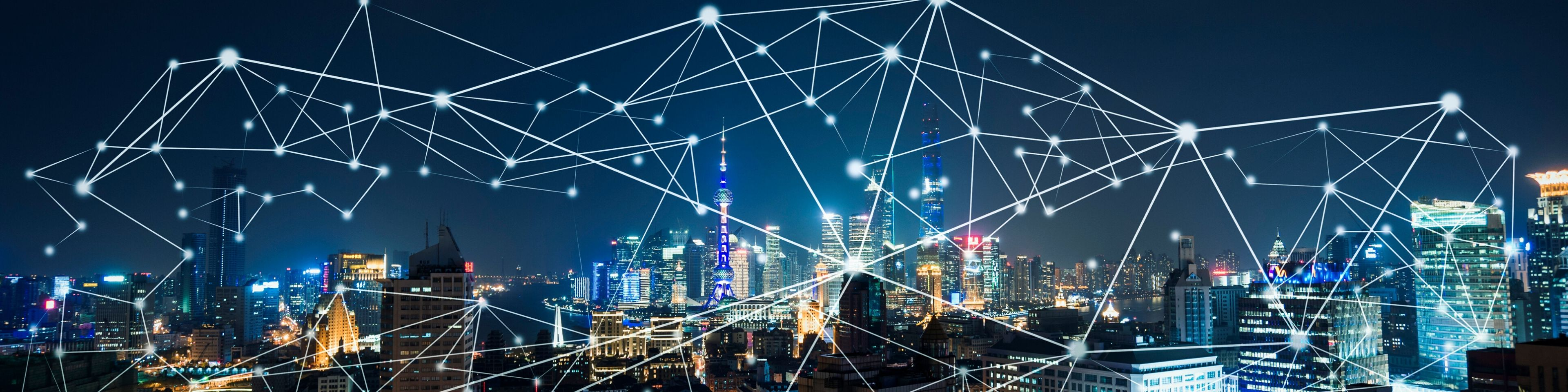 data network connections over the city at night