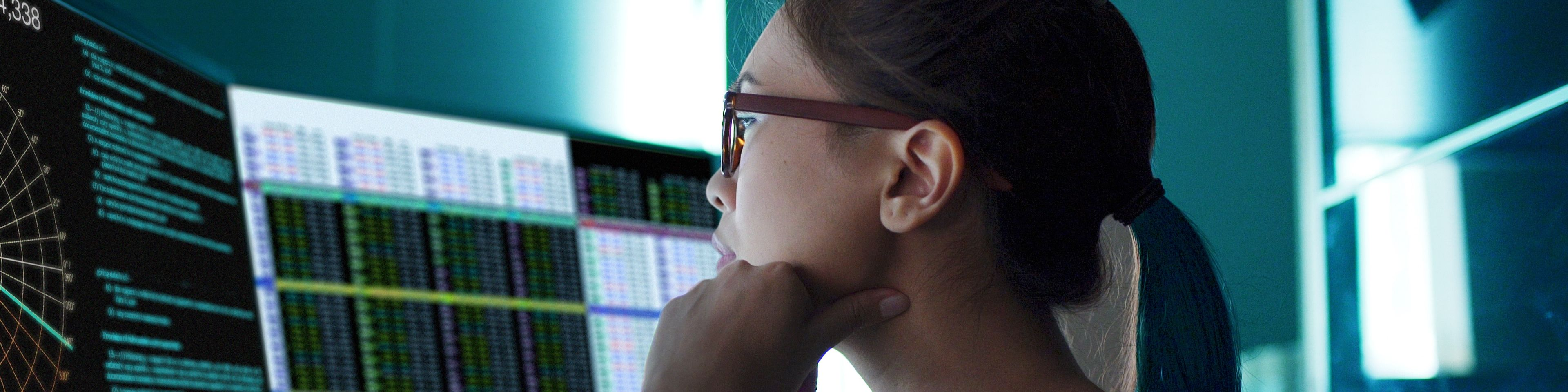 female accountant looking at data on a computer screen