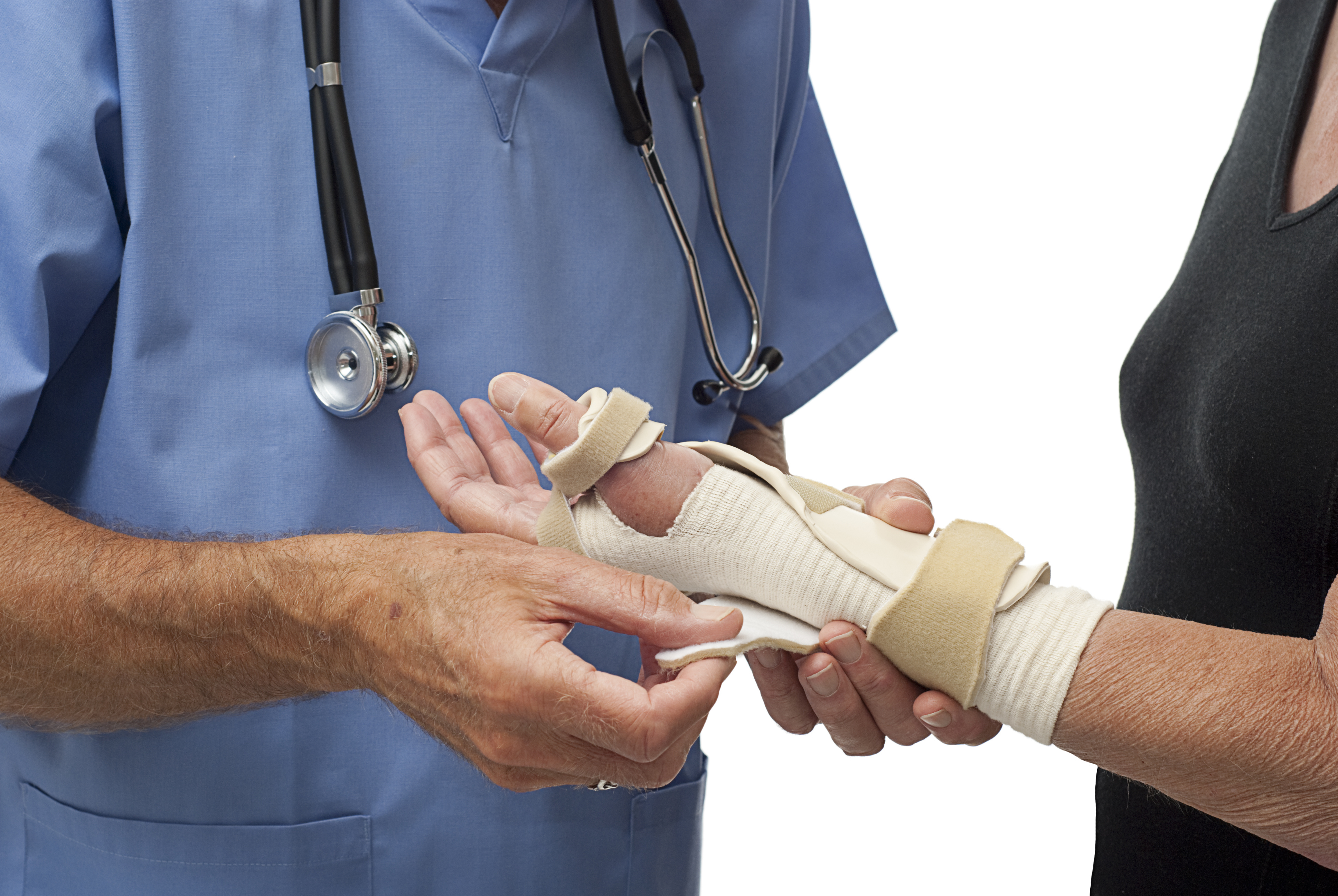 Doctor fitting splint on woman's wrist