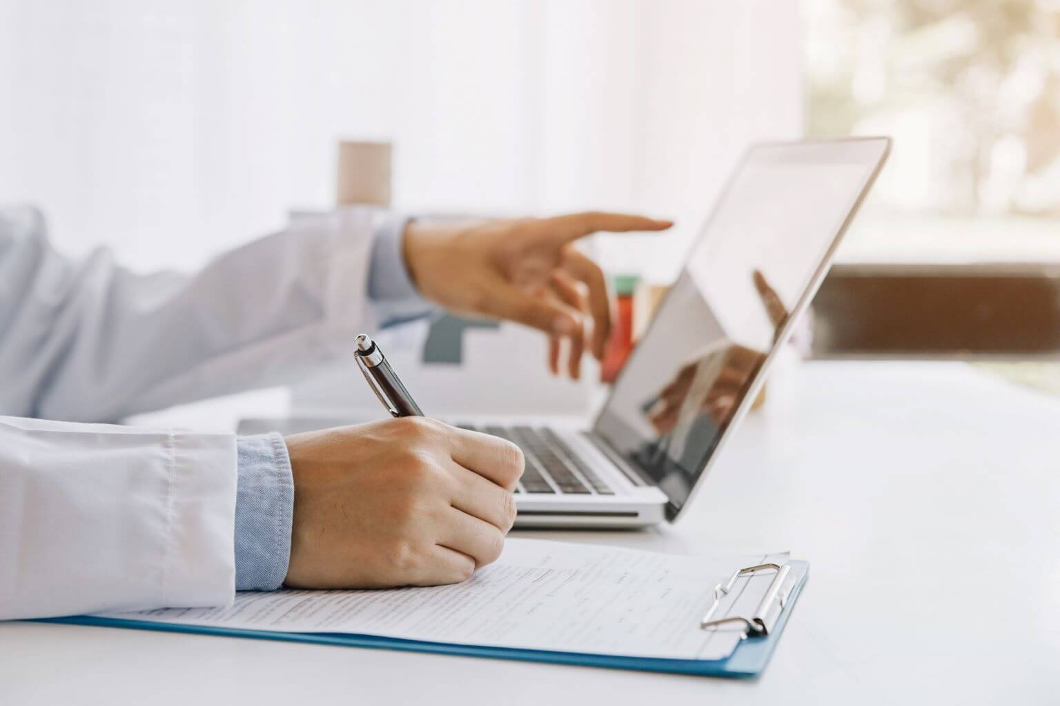 doctor-taking-notes-from-computer