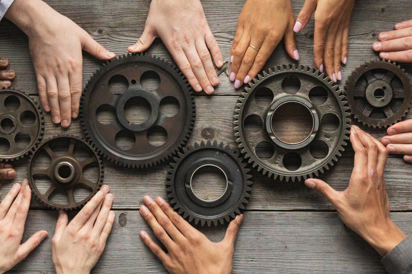 Combined Assurance Hands Holding Gears