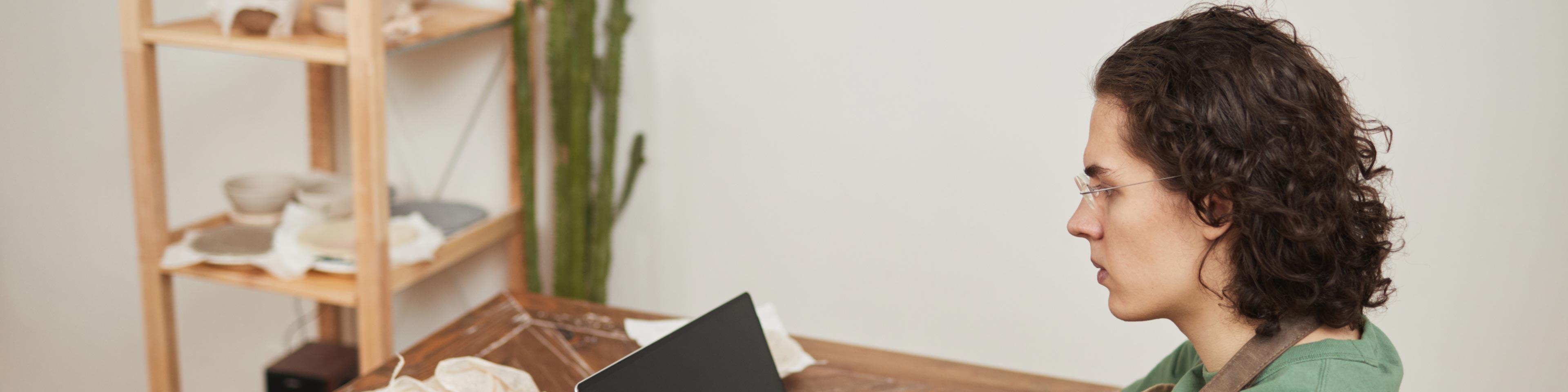 woman on laptop studying tax evasion