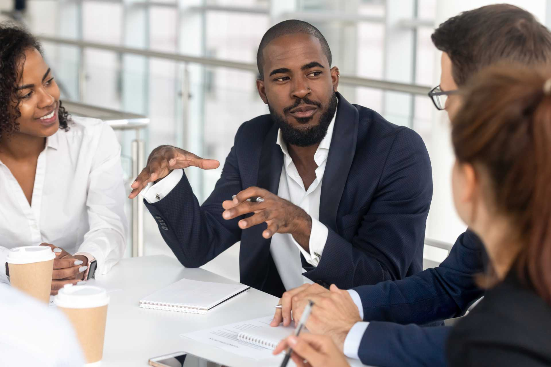 Man leads group meeting