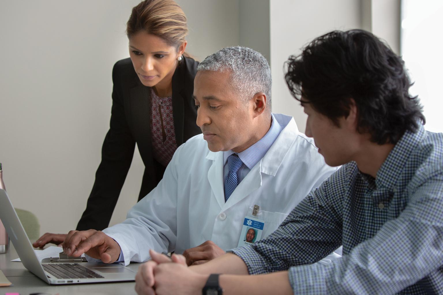 hospital staff veiwing laptop