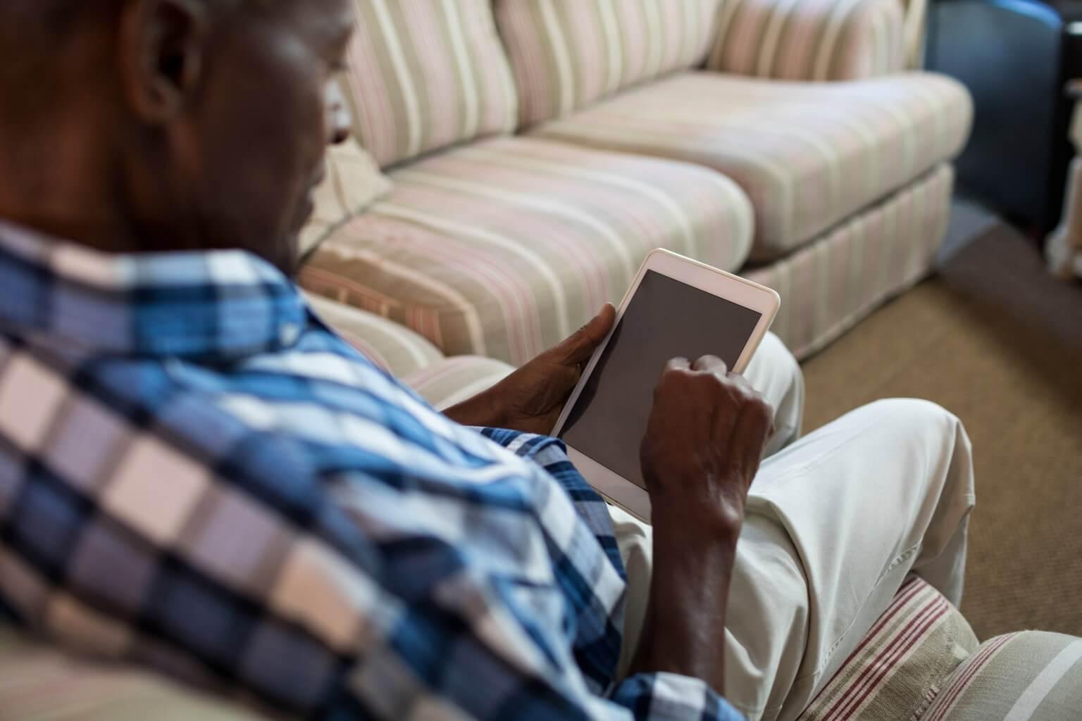 Elderly man consulting a physician via telemedicine