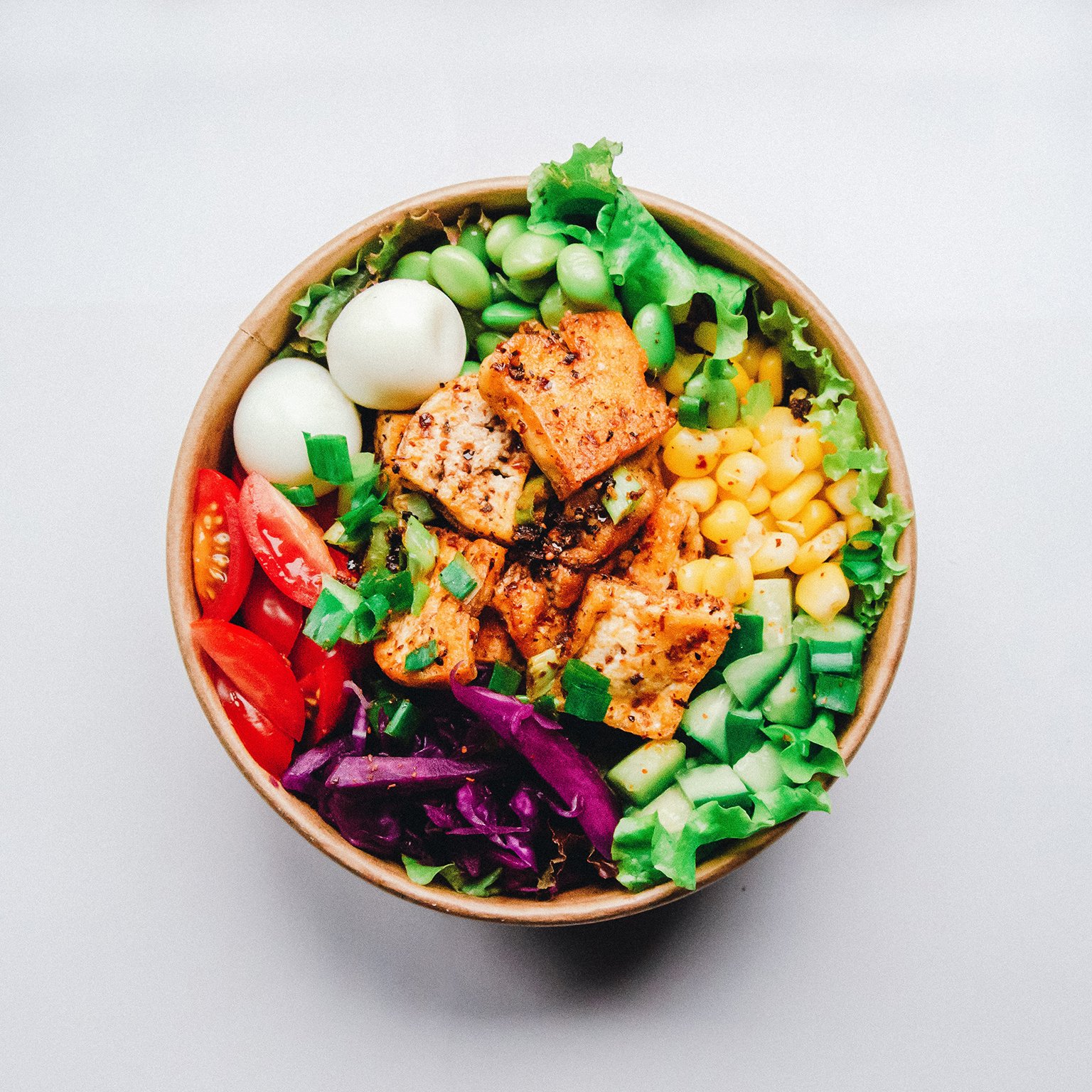 bird's eye view of healthy salad bowl with lots of proteins
