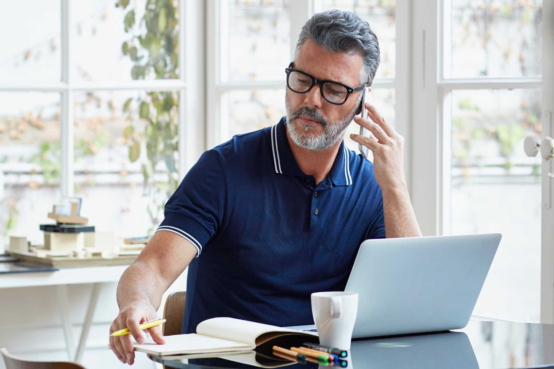 Mature man on laptop and phone