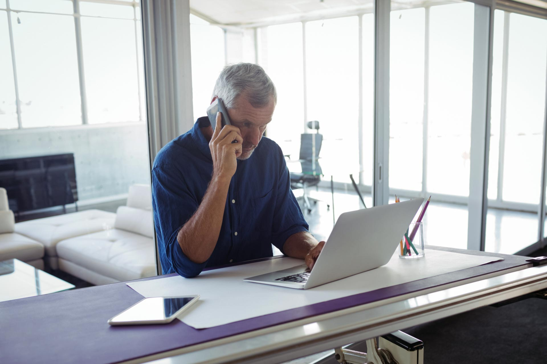 Man reinstating his business on the phone
