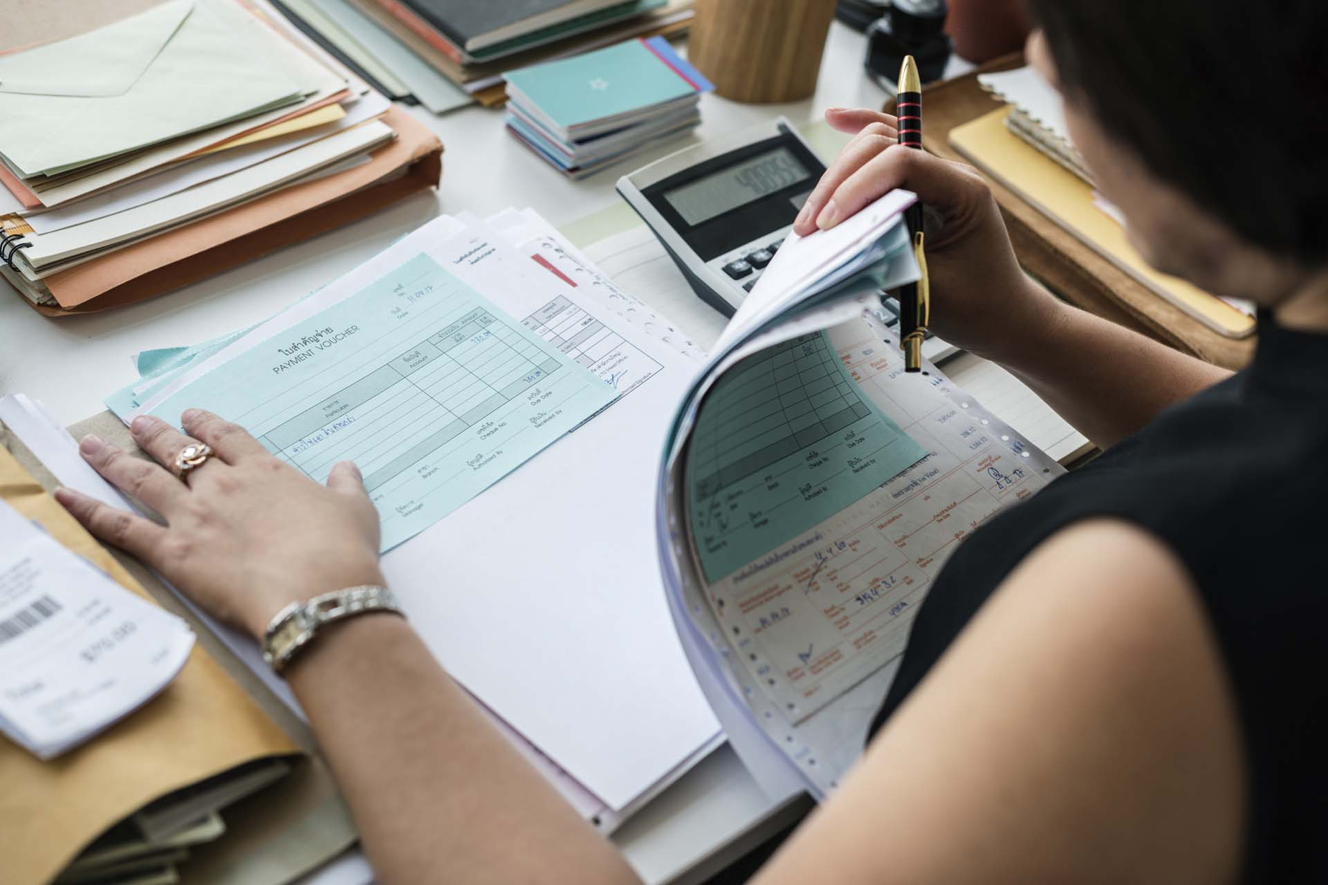 woman reviewing factoring documents