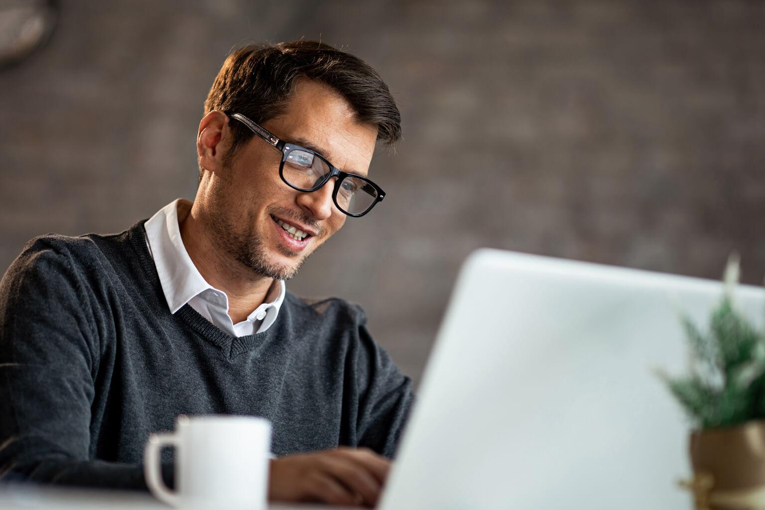 Caucasian man on laptop
