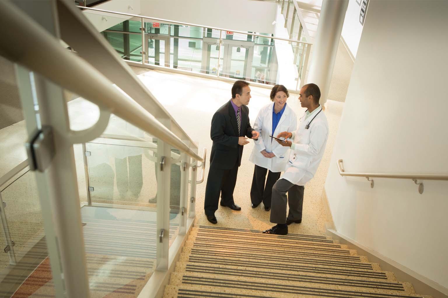 group of doctors on stairway landing