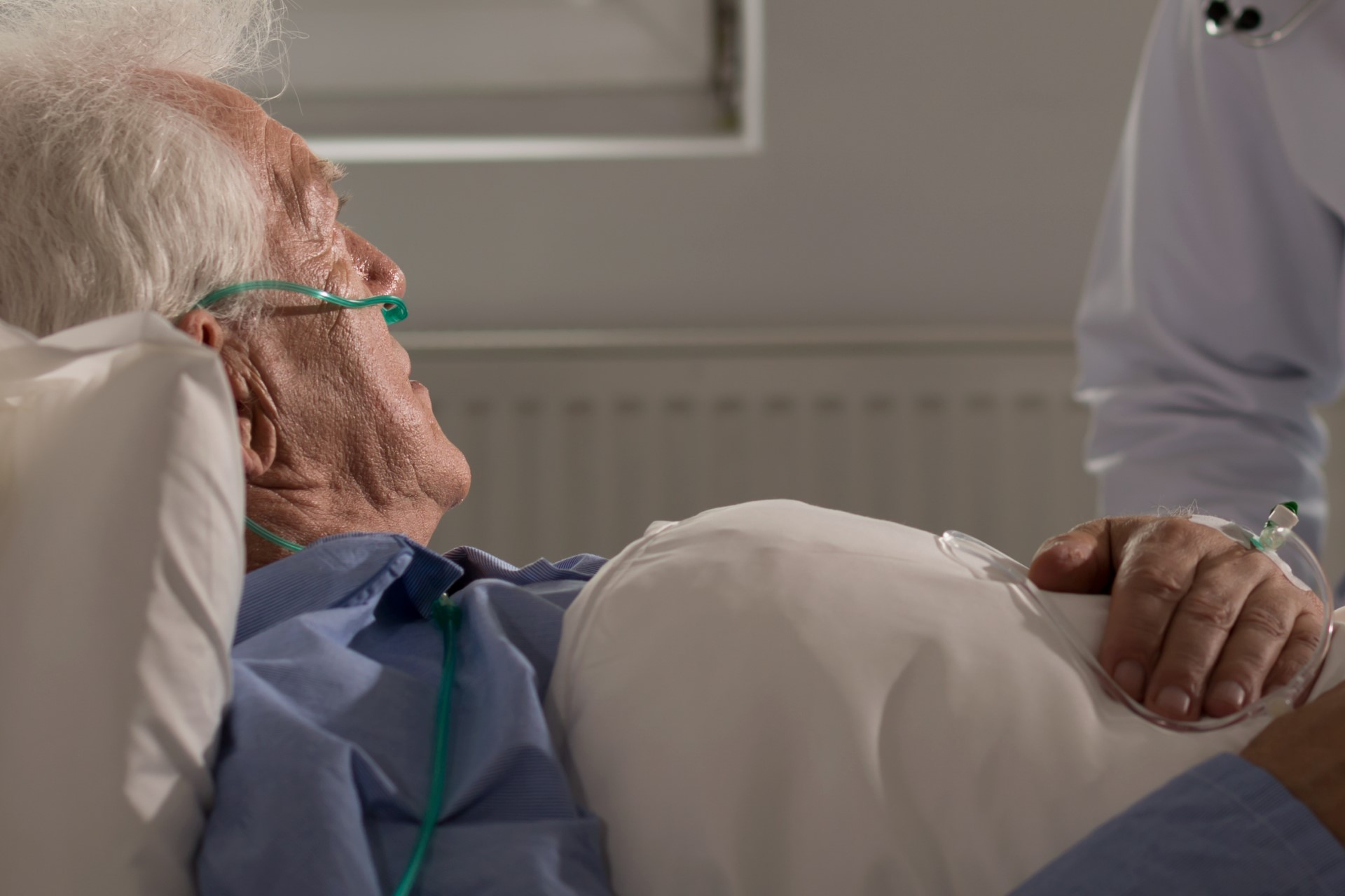 Older patient in a hospital bed