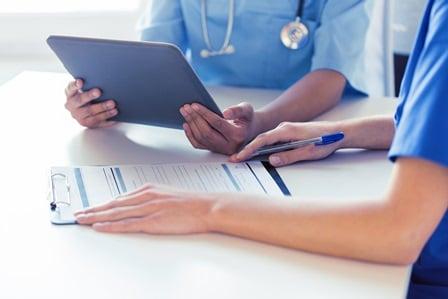 Nurses filling out a form