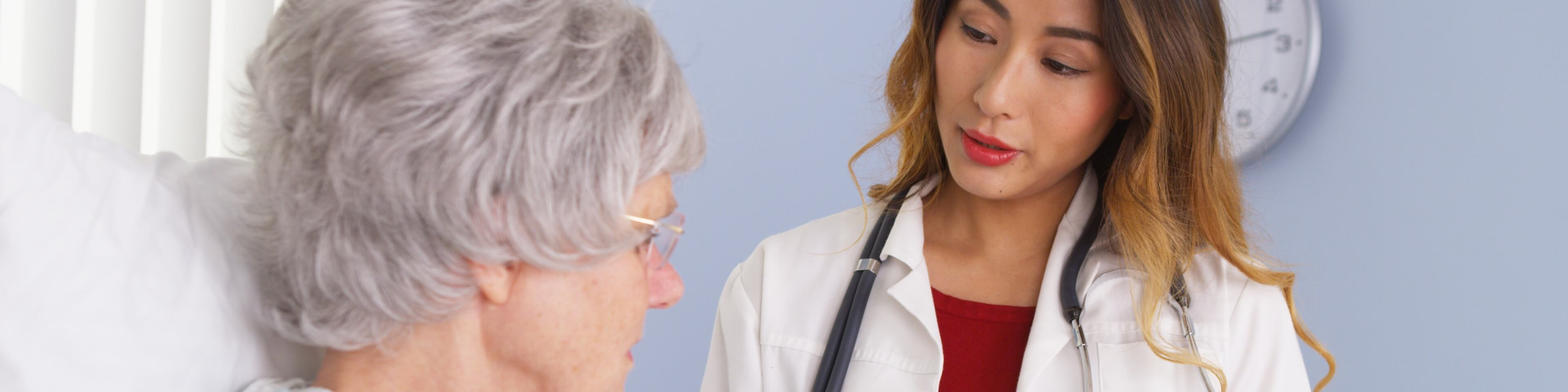 Female doctor speaking with a patient