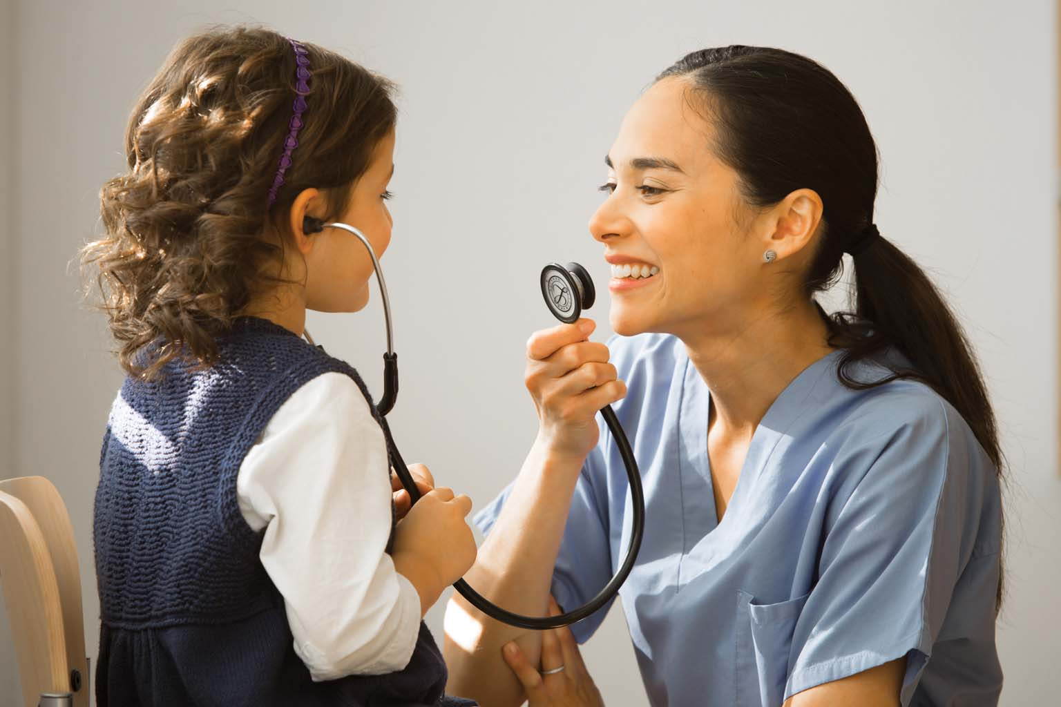 resident with child and stethescope