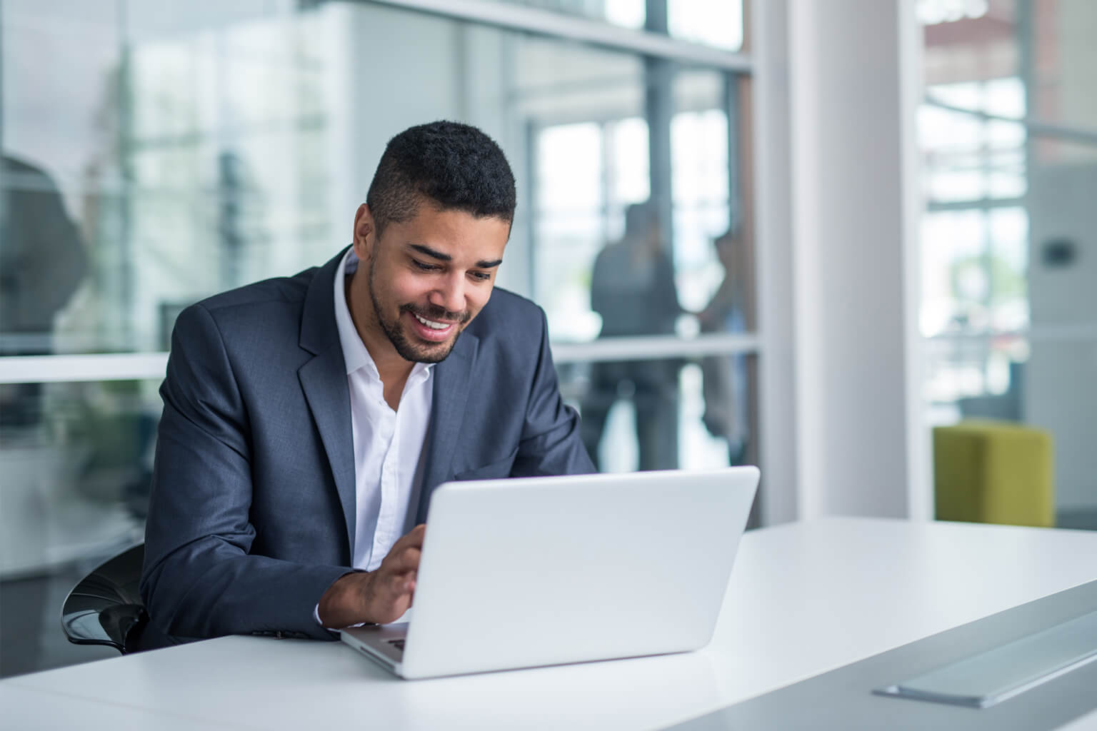 Guy sitting in front of computer