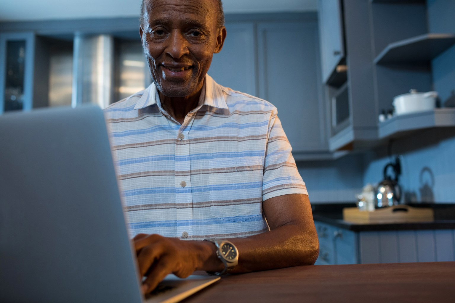 Elderly gentleman consulting a doctor via telehealth