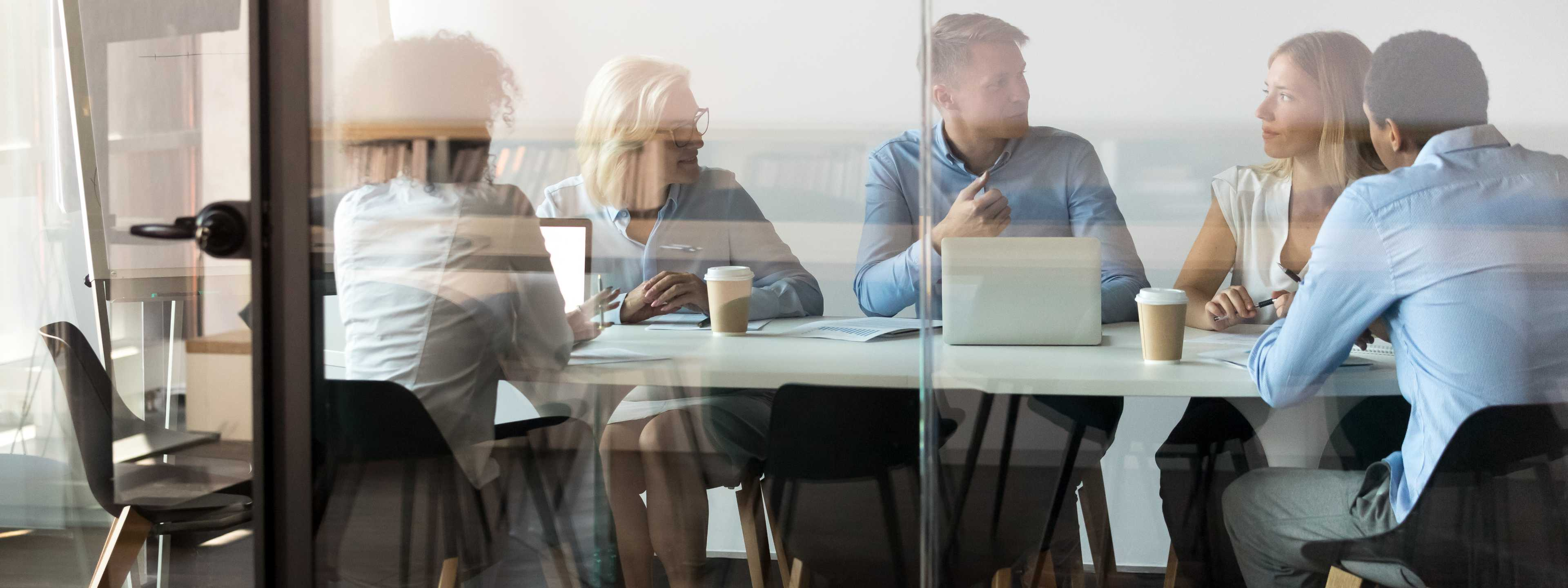 Group meets at conference table