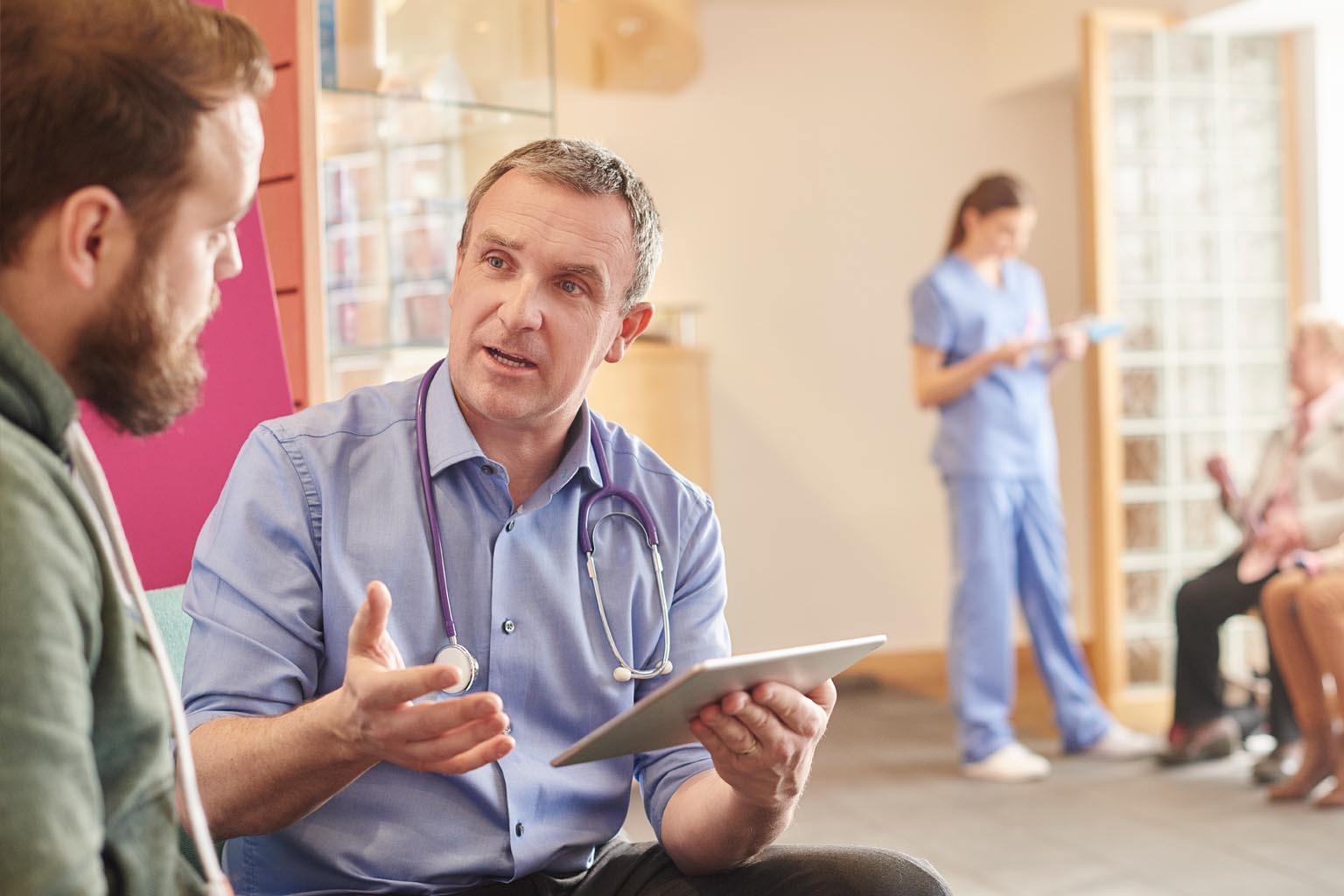 clinicians with patients and devices in lobby