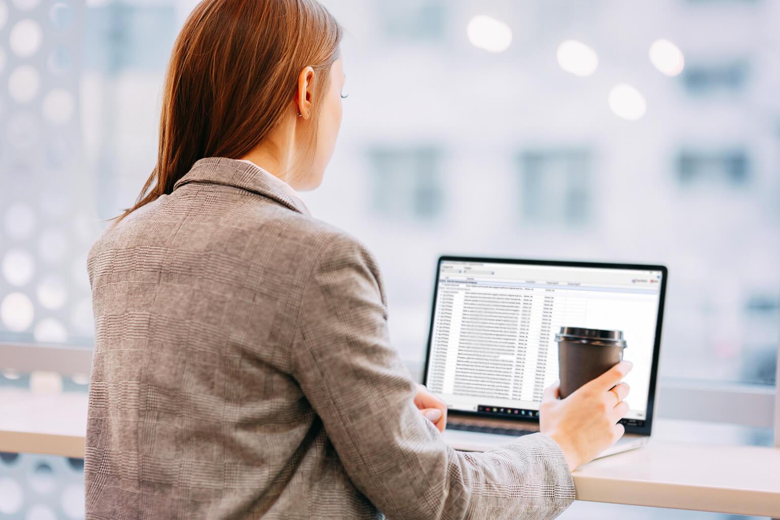 auditor working at laptop