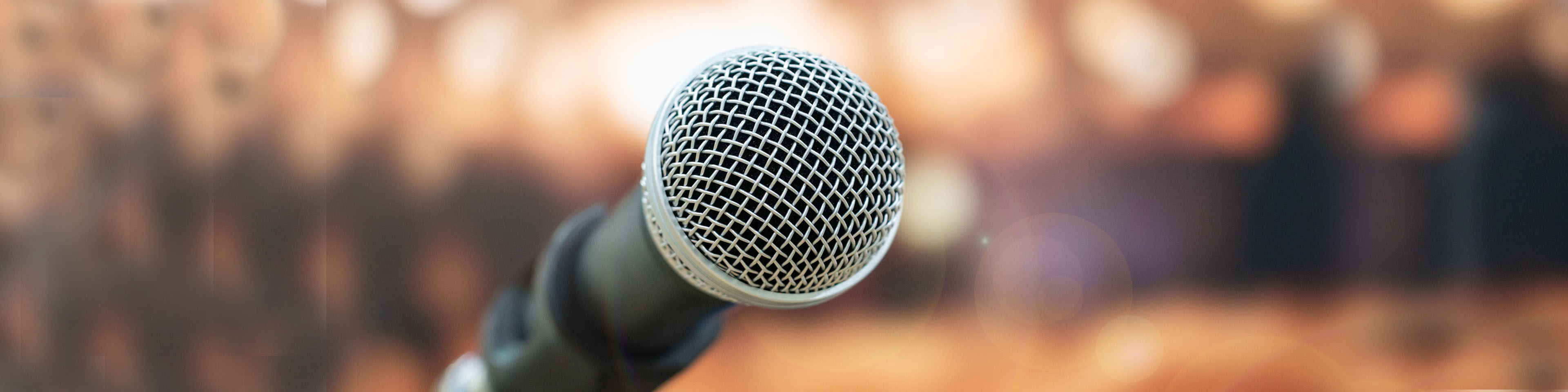 Microphones on abstract blurred of speech in meeting room front speaking blur people in even