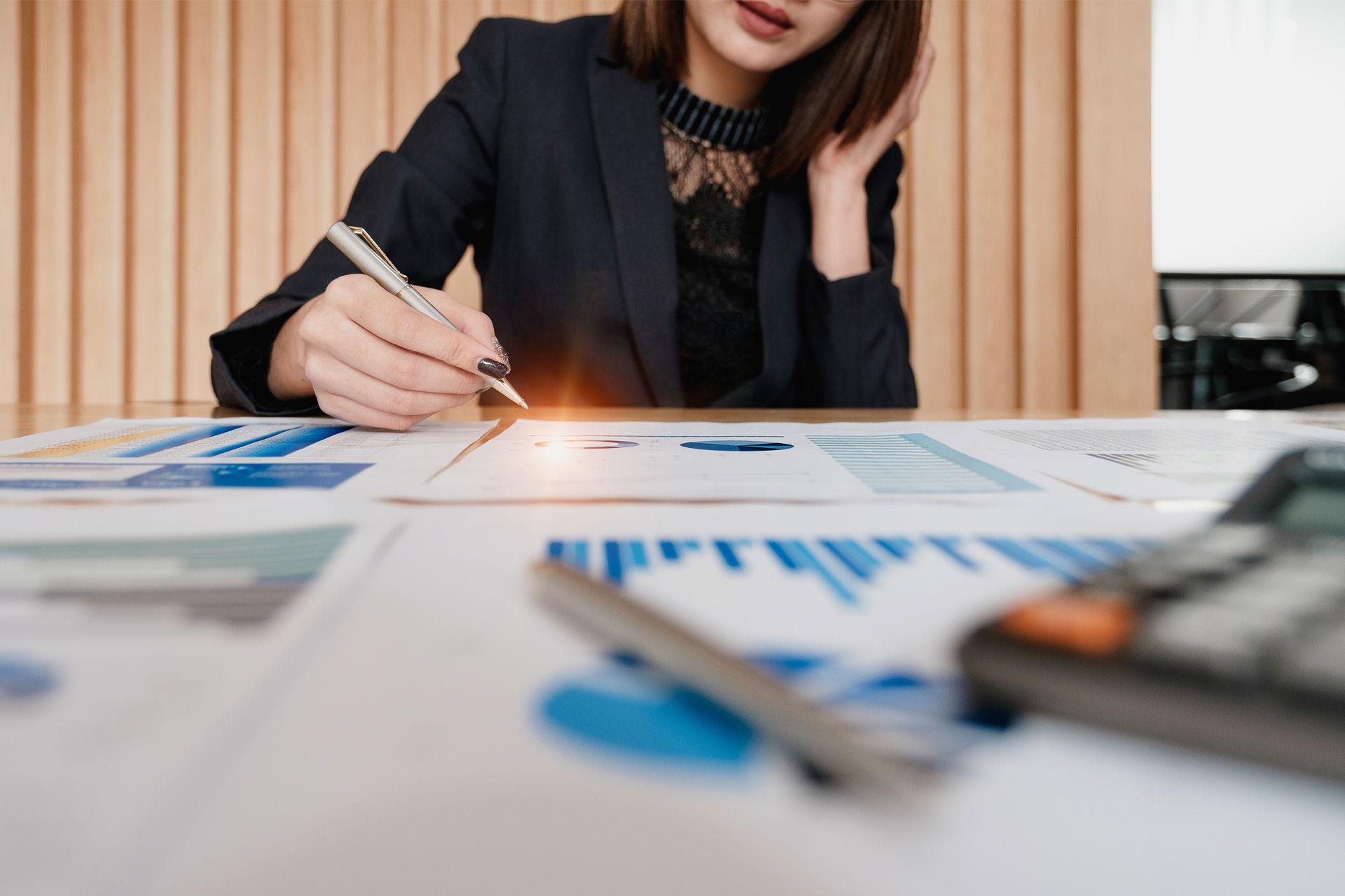 businesswoman viewing analytics paperwork