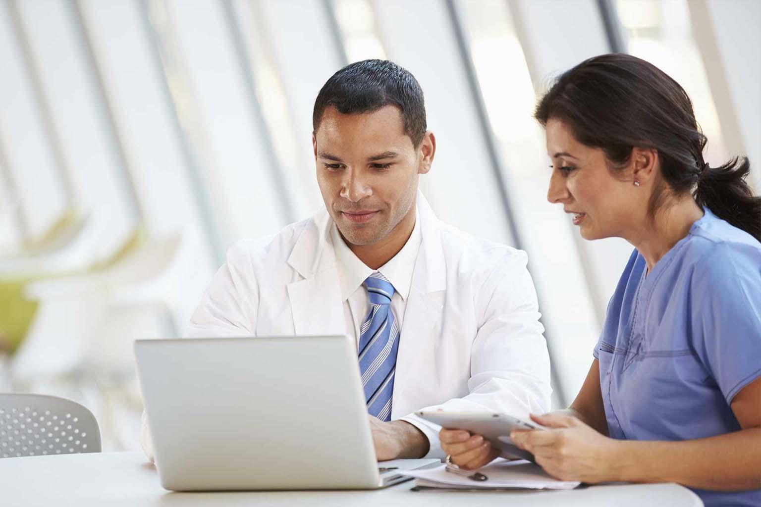 clinicians using laptop