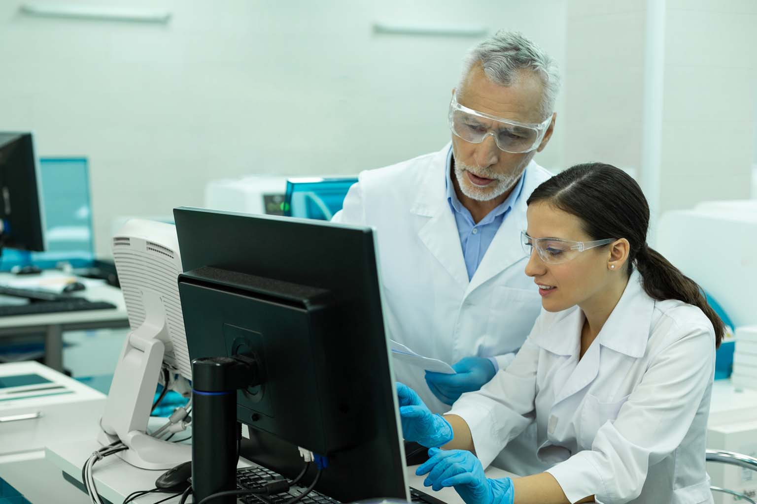 pharmacists in lab using computer