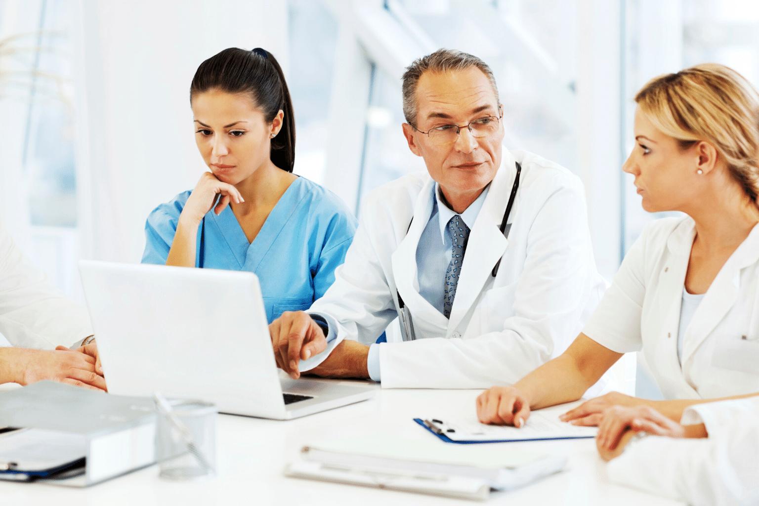 Clinicians discussing an ASP program