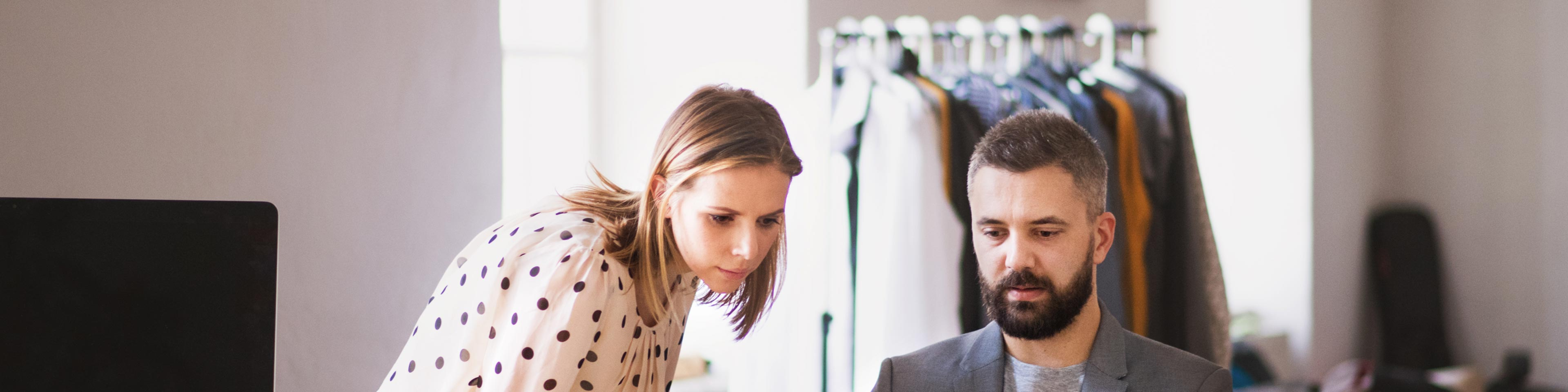woman and man reviewing sales tax in the reselling industries