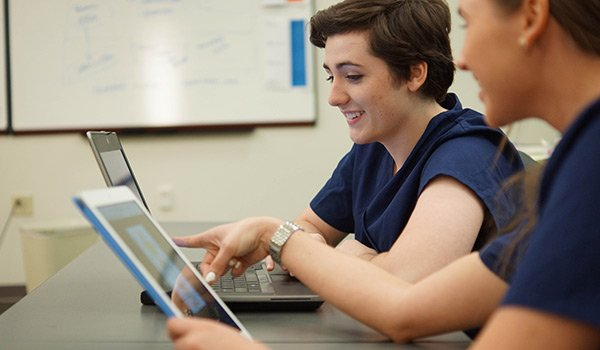 Nursing students in a classroom using an educational EHR, Lippincott DocuCare