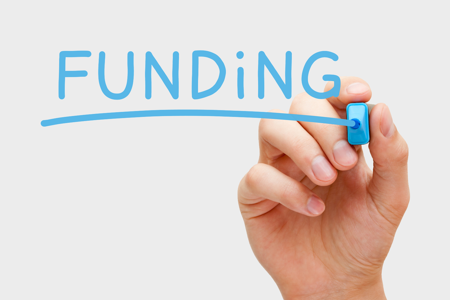 A hand writing funding in blue marker