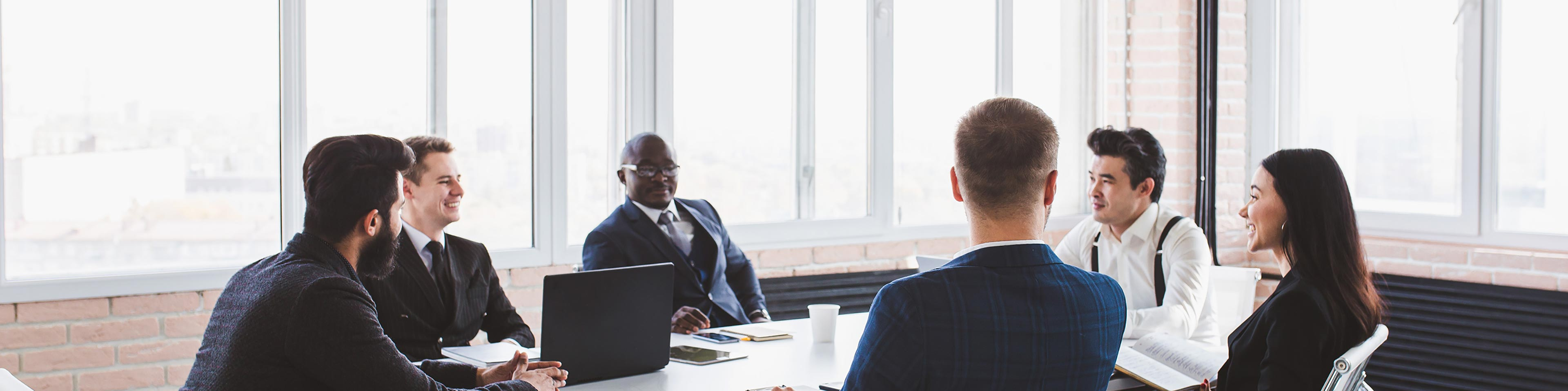 Business people sitting around a table in a meeting