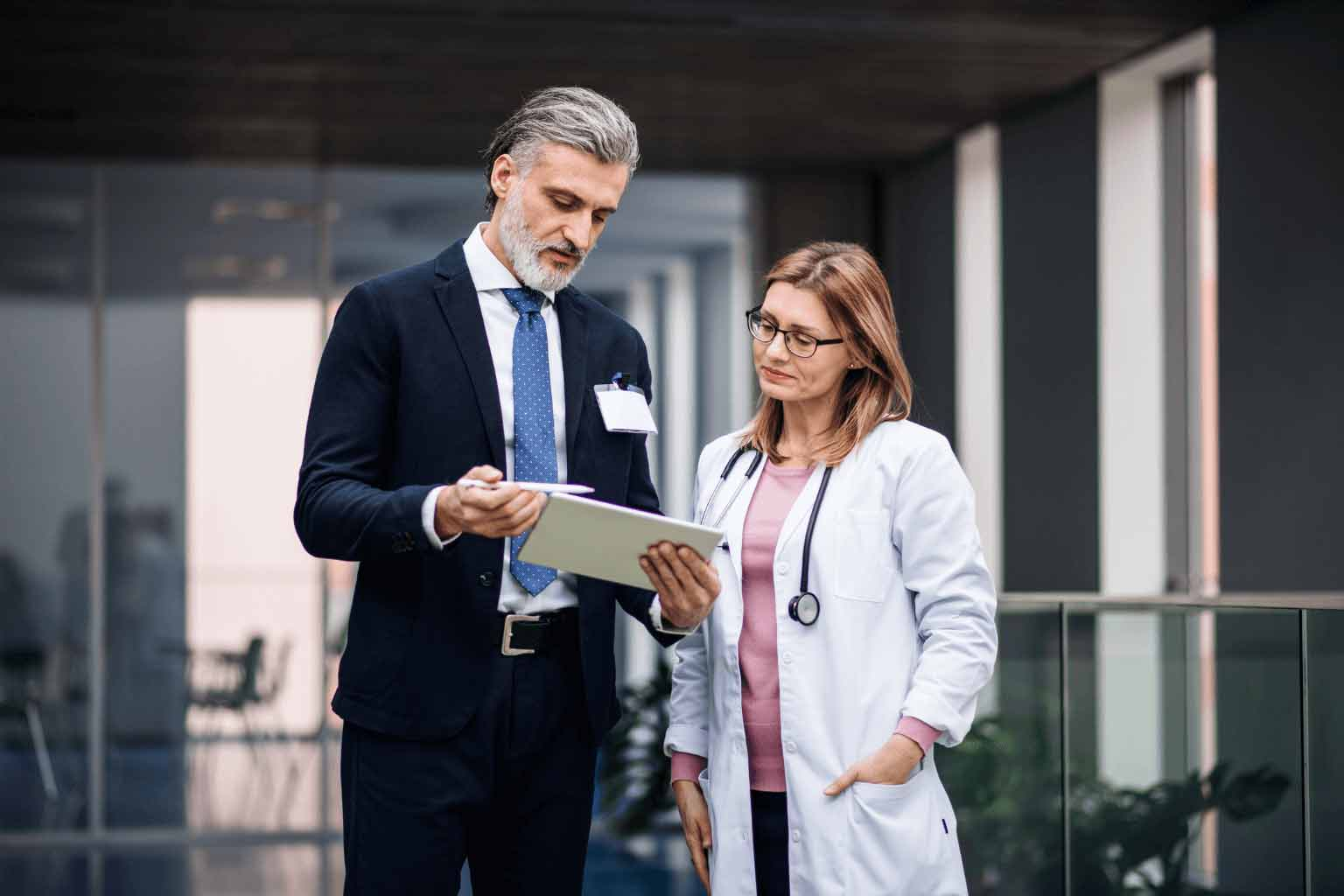 Female-doctor-shaking-hands-with-businessmanjpg