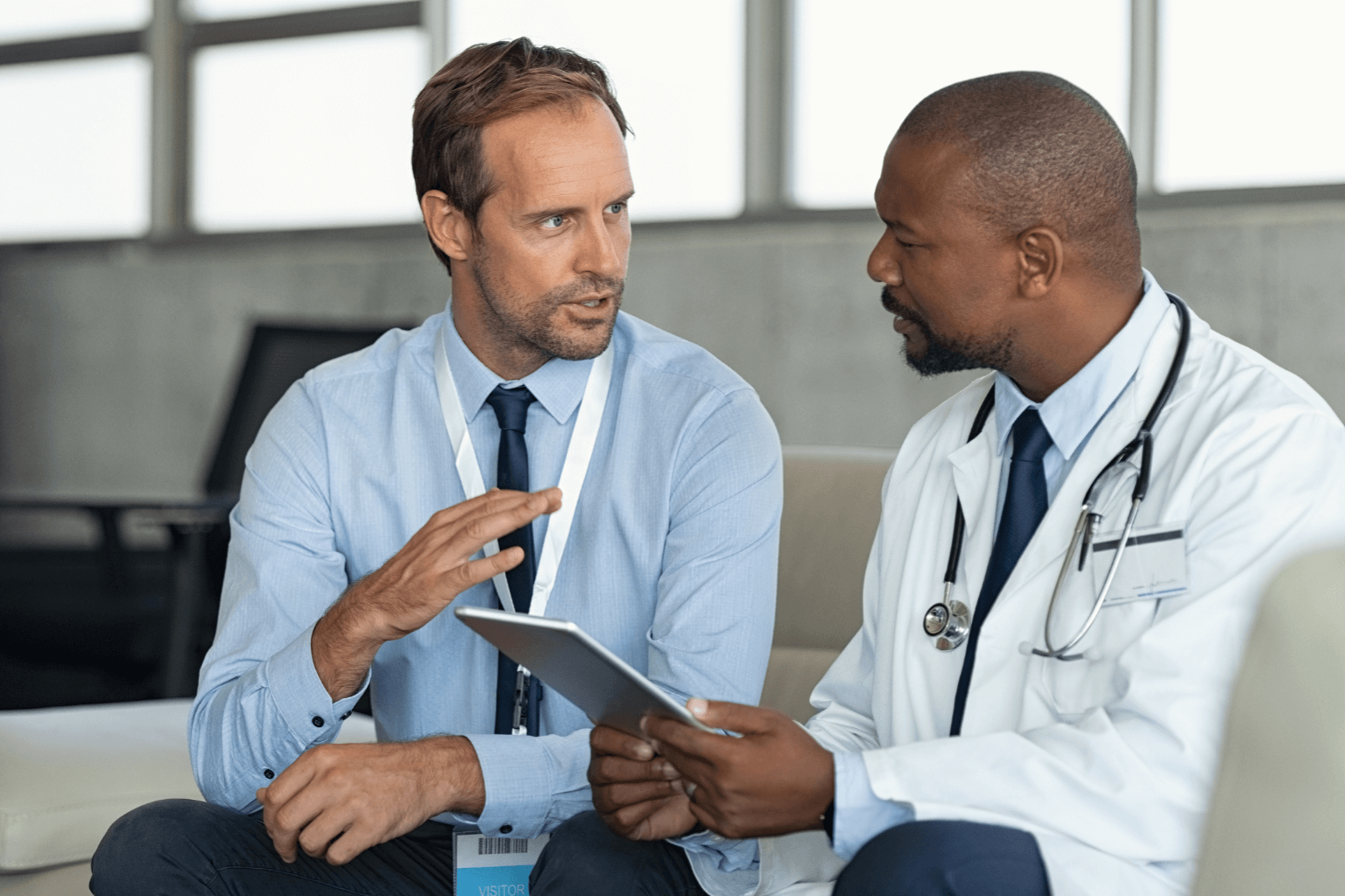 representative talking with doctor