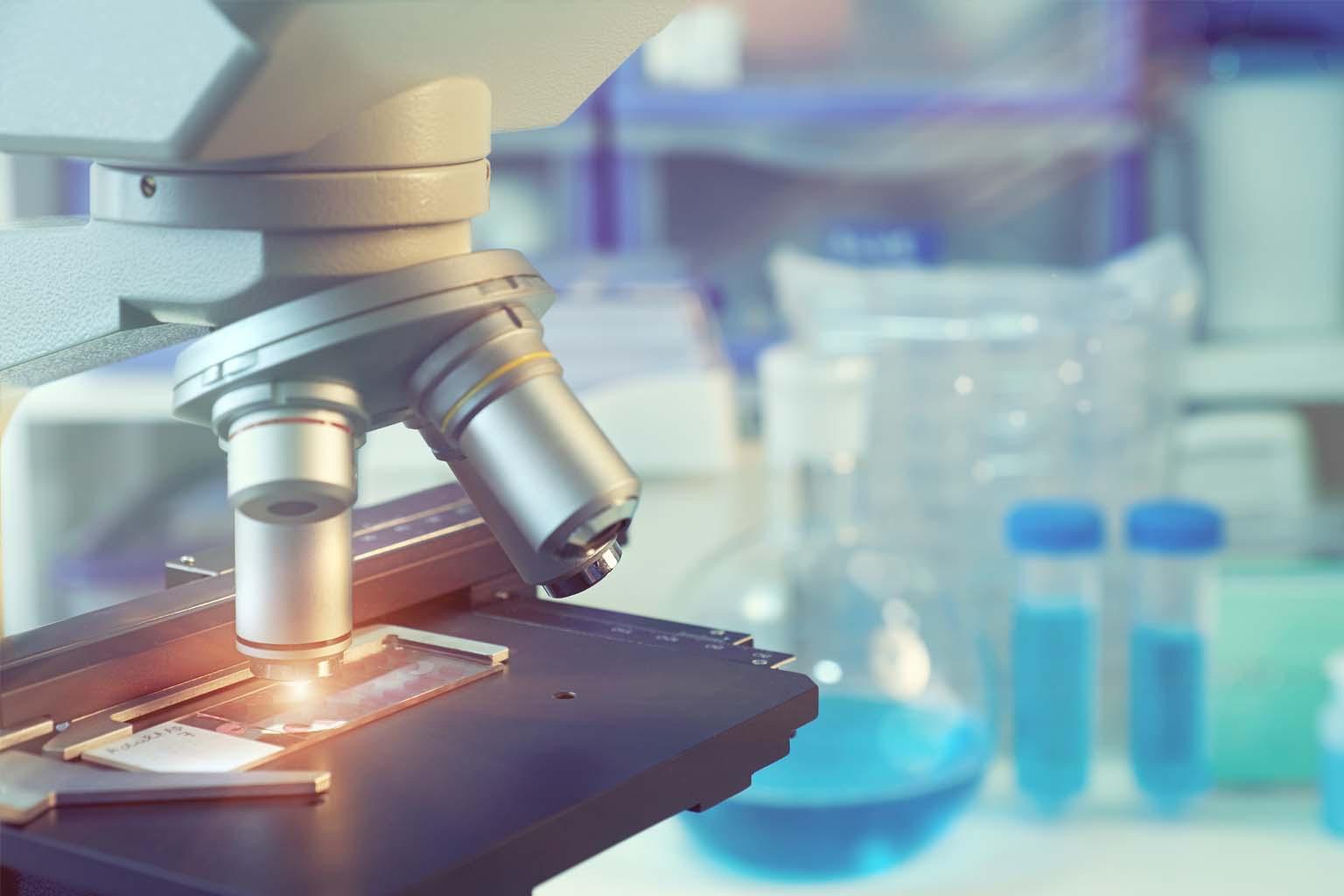 closeup of microscope in lab setting