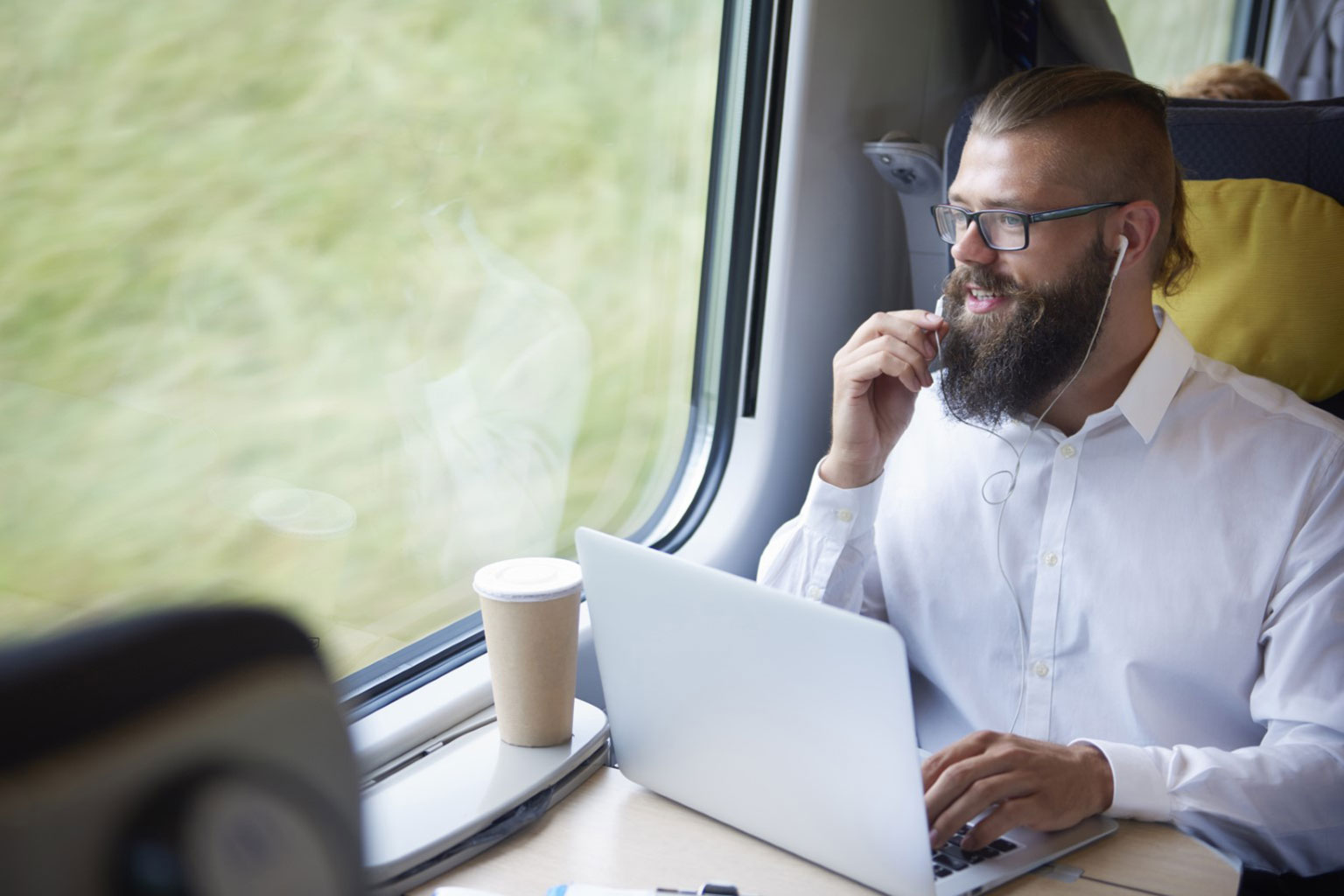 Person on train with laptop