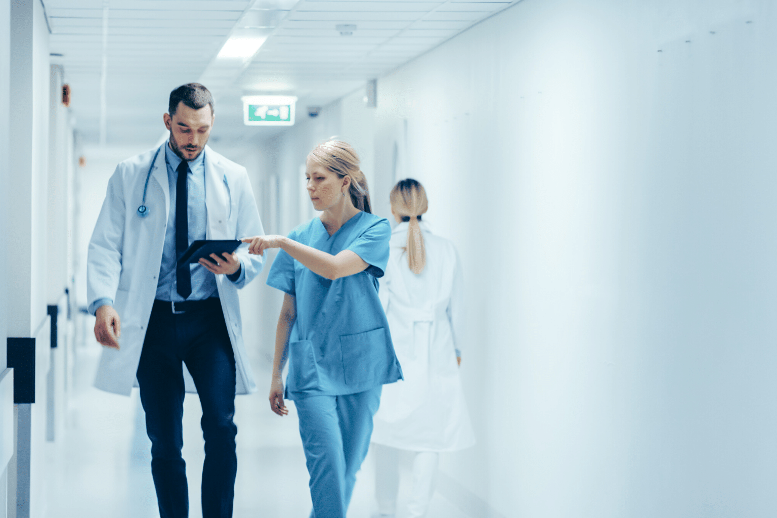 Clinicians in the hospital hallway