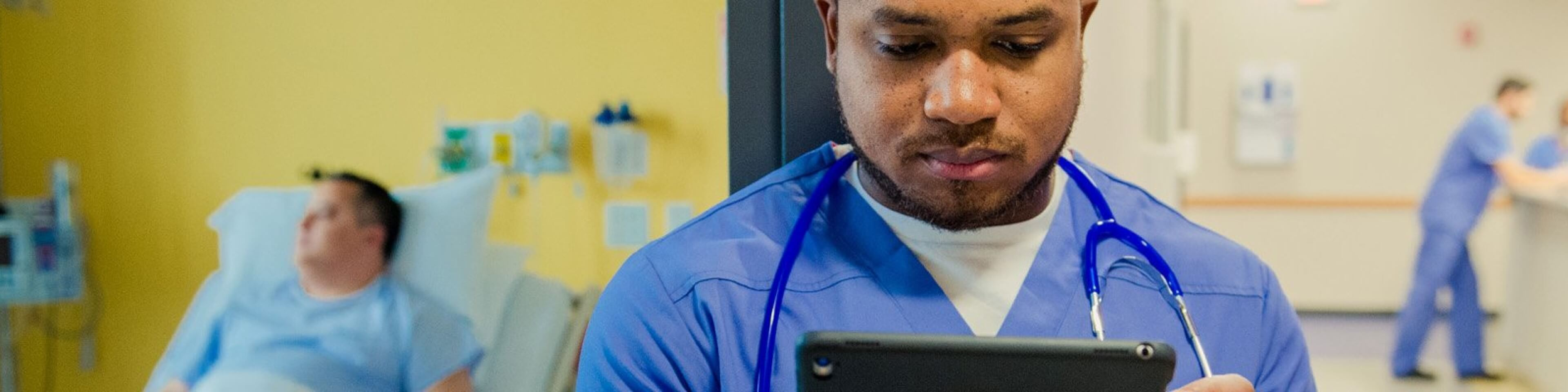 Doctor looking at patient data on a tablet
