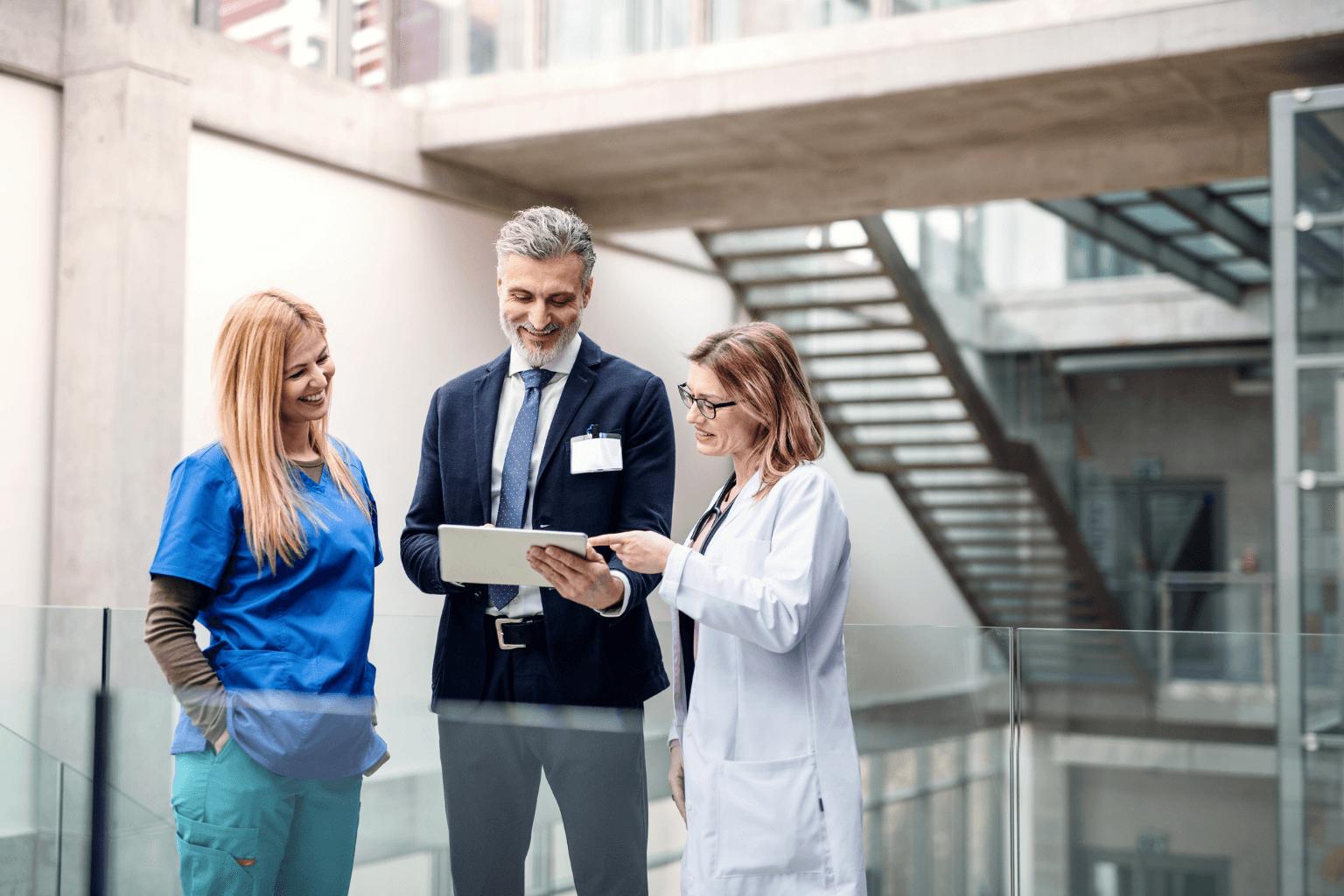 Group-of-doctors-talking-to--sales-representative-jpg