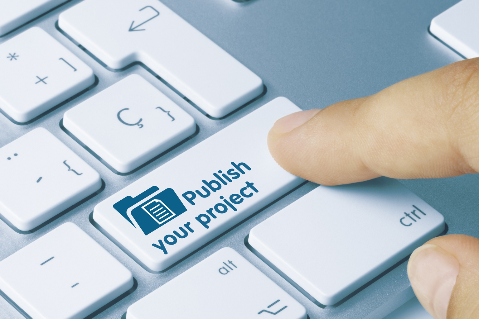 Finger pushing keyboard button that says Publish your project