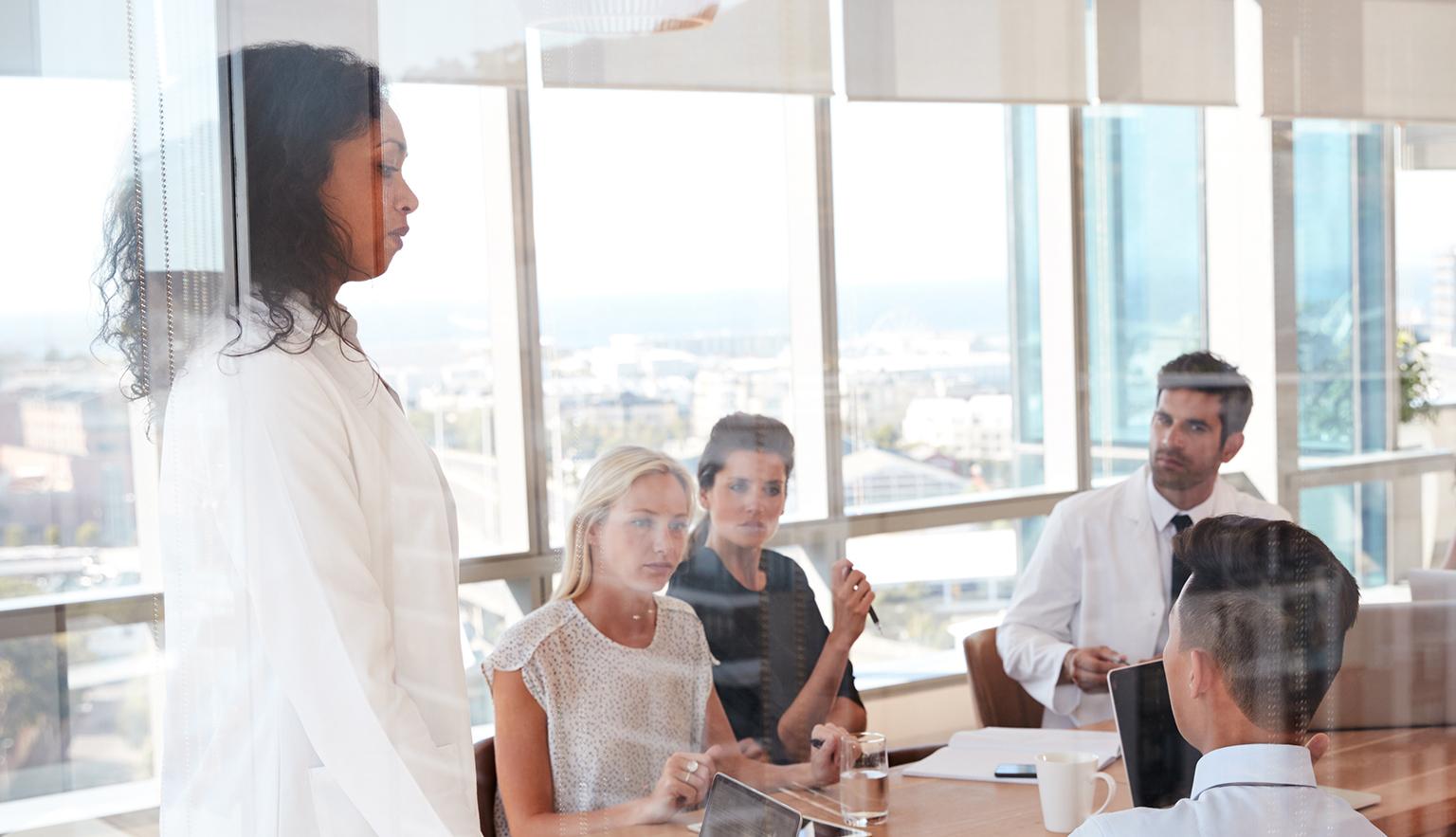 Healthcare workers meeting in a hospital meeting room
