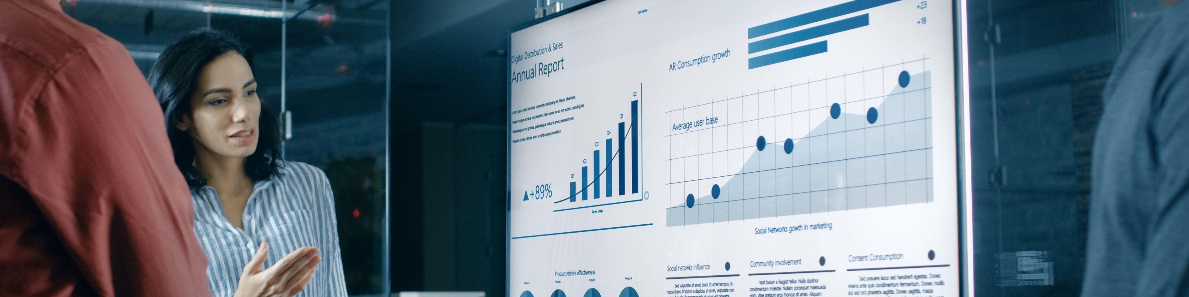 business meeting looking at data charts