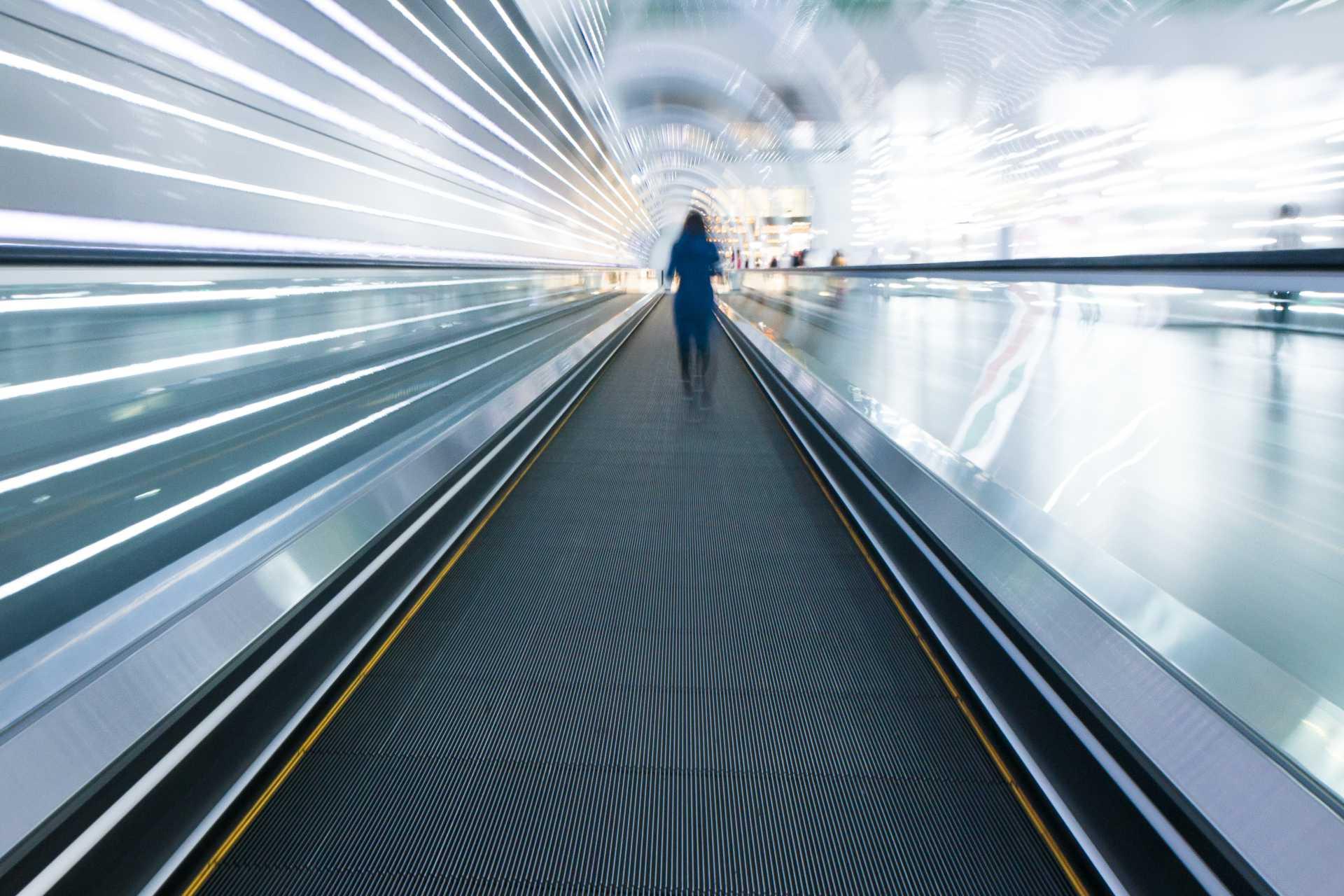 Woman in high tech walkway