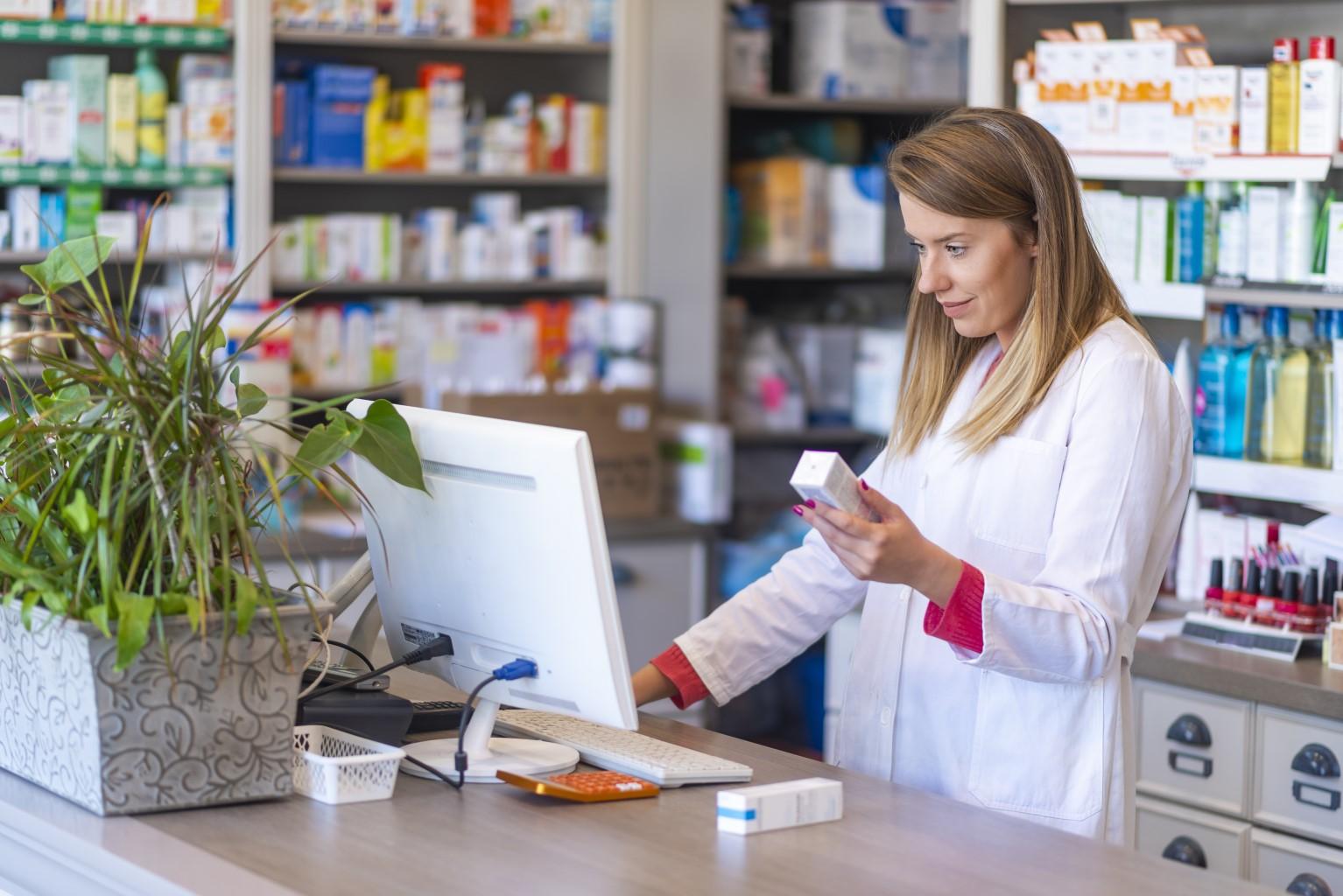 Pharmacist on a computer