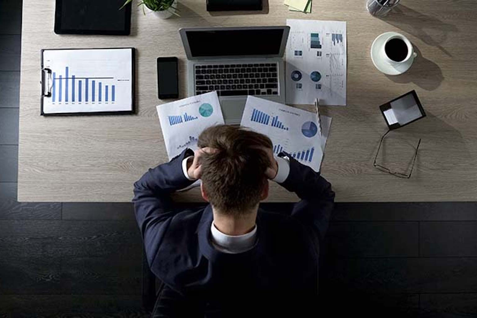 Man in front of desk and computer