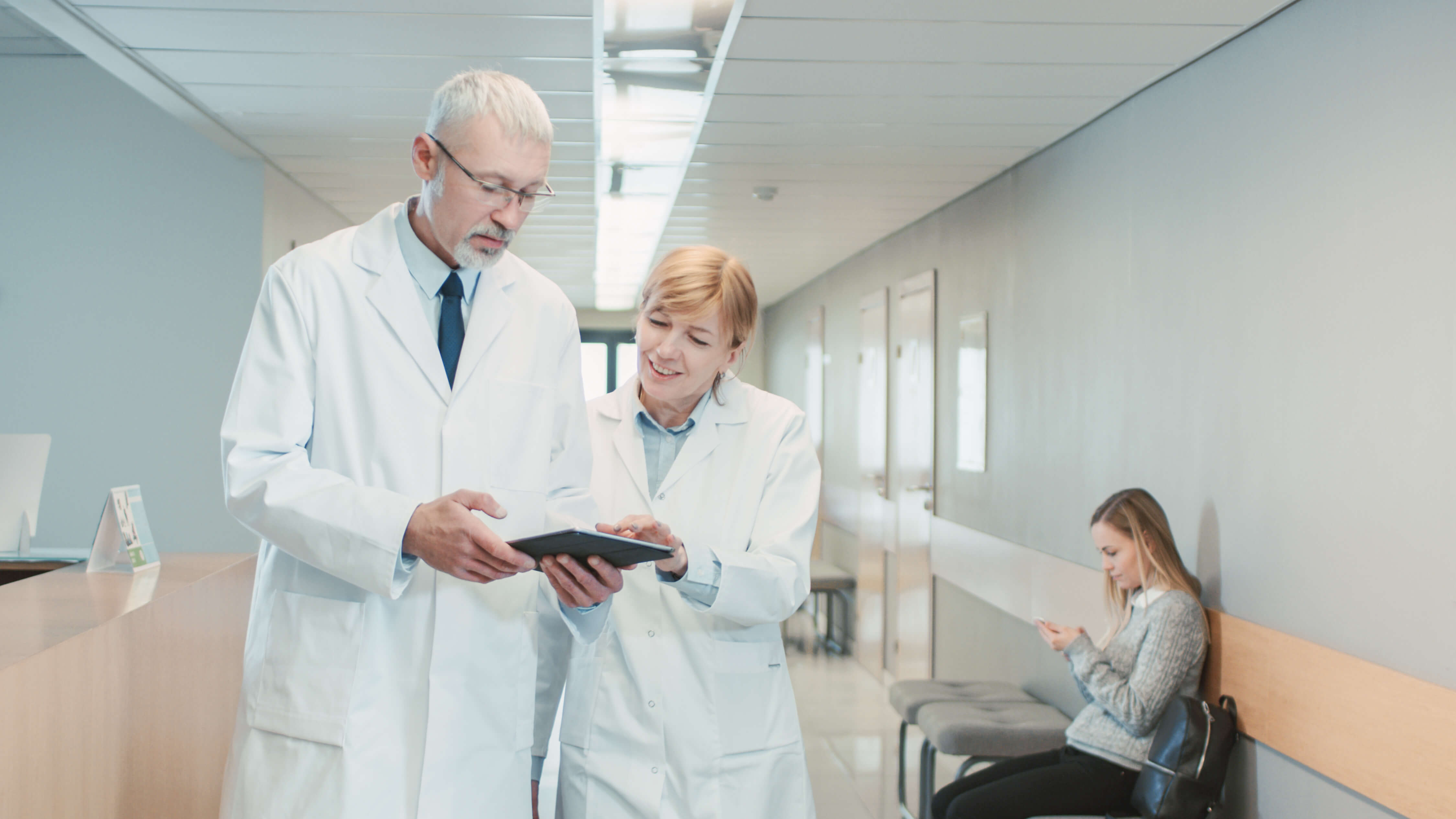 Two clinicians walking