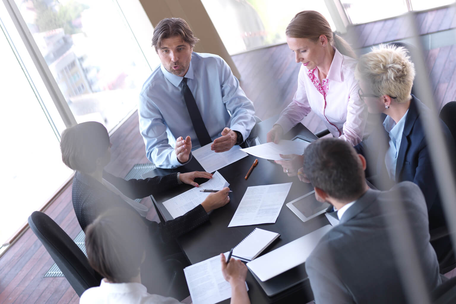 Group of people discussing business