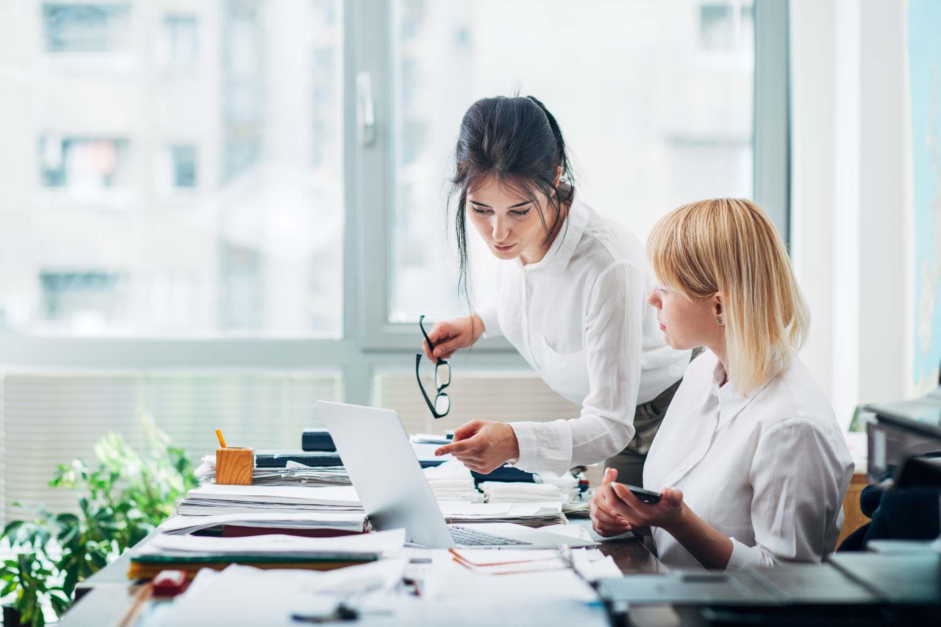 two women reviewing their lien portfolios
